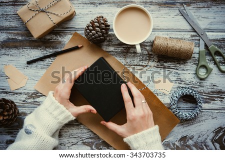 Christmas or New year gift packing. Holiday decor concept. Toned picture