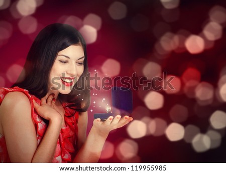 Christmas or New Year Gift. Surprised Woman
