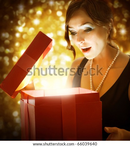 Christmas or New Year Gift.Surprised Woman