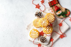 Christmas or New Year homemade sweet present mini cakes with icing sugar. White stone table background. Festive decoration. Flat lay, top view, copy space.
