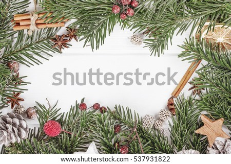 Christmas or New Year white wooden background, board framed with season decorations, space for a text. #537931822