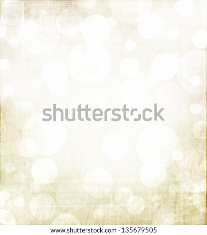 Christmas or winter abstract background with golden tones and a grunge metallic overlay.
