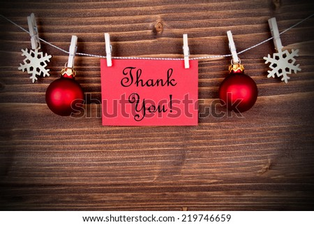 Christmas or Winter Background with a Red Label with the Words Thank You on a Line