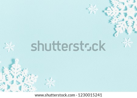 Christmas or winter composition. Pattern made of snowflakes on pastel blue background. Christmas, winter, new year concept. Flat lay, top view, copy space #1230015241