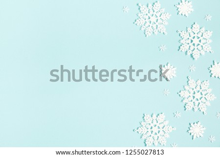 Christmas or winter composition. Pattern made of snowflakes on pastel blue background. Christmas, winter, new year concept. Flat lay, top view, copy space #1255027813