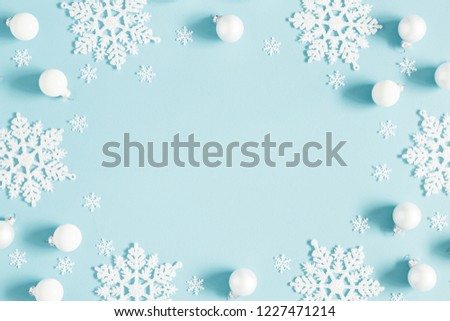 Christmas or winter composition. Pattern made of white balls and snowflakes on pastel blue background. Christmas, winter, new year concept. Flat lay, top view, copy space