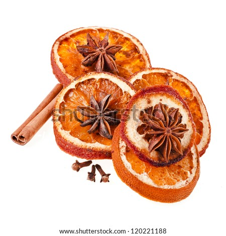 Christmas orange with cinnamon and anise on a white background