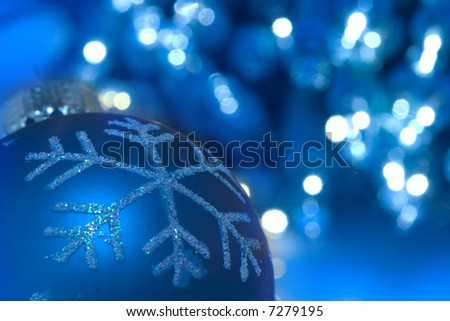 Christmas ornament against sparkling blue background