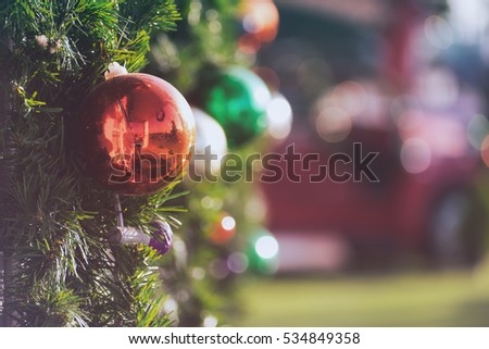 Christmas ornament ball for Xmas New Year festival decorate on pine tree background.