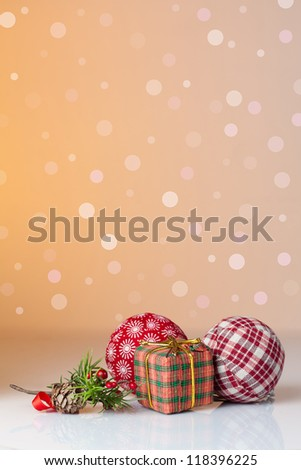 Christmas ornament: Christmas gifts in colorful wrapping with golden ribbons and christmas balls with a background of defocused lights