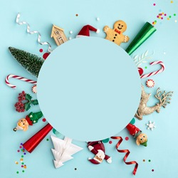Christmas ornament flat lay background on blue, overhead view