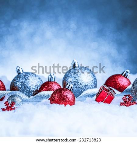 christmas ornament in snow on glitter background. studio shot #232713823