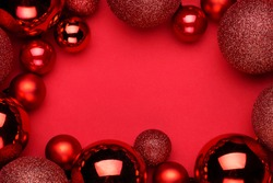 Christmas ornament on the red background. Top view with copy space for your text.