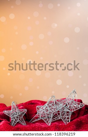 Christmas ornament: silvered stars with a background of defocused lights