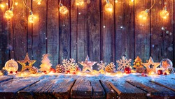Christmas Ornament With String Lights On Rustic Wooden Table