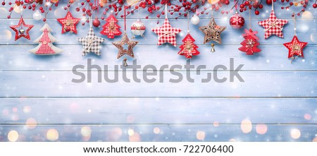 Christmas Ornaments And Berries Hanging On Snowy Wooden #722706400