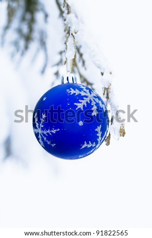Christmas Ornaments blue glass ball outdoors. Copy space