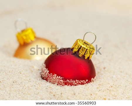 christmas ornaments in sand - the concept of a warm weather xmas