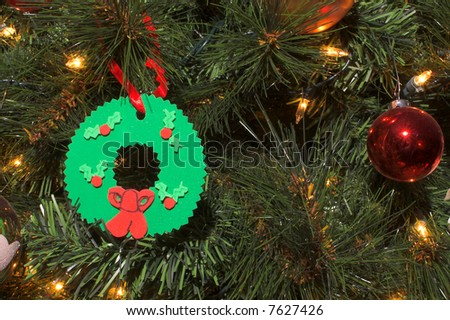 Christmas ornaments on a decorated holiday tree.