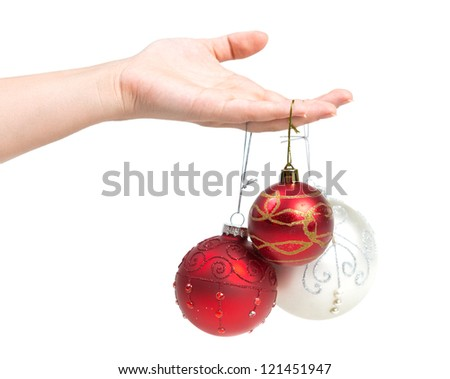 Christmas ornaments on a hand, white background