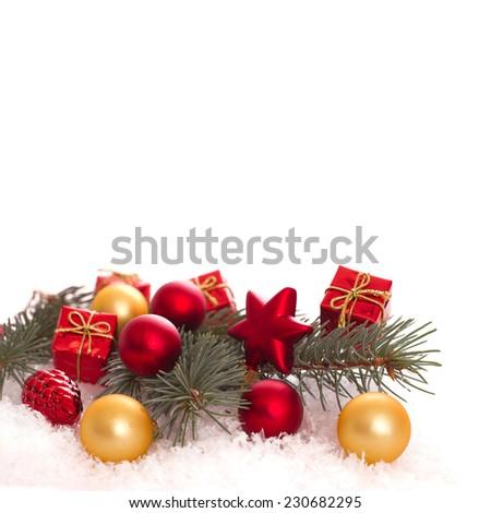 Christmas ornaments on Christmas tree. Christmas border with ornament, present and snow