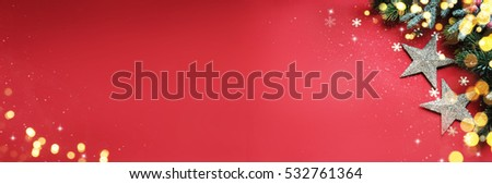 Christmas ornaments on red background, border design, top view #532761364