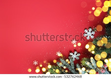Christmas ornaments on red background, border design, top view #532762468