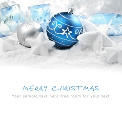 Christmas ornaments on snow,Copy space for your text.