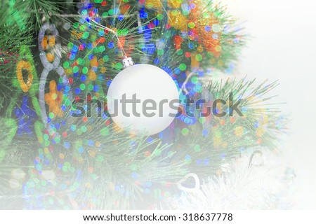 Christmas ornaments on the Christmas tree and Christmas background of de-focused lights on soft focus.