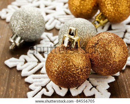 Christmas ornaments on the wooden background. Shallow dof.