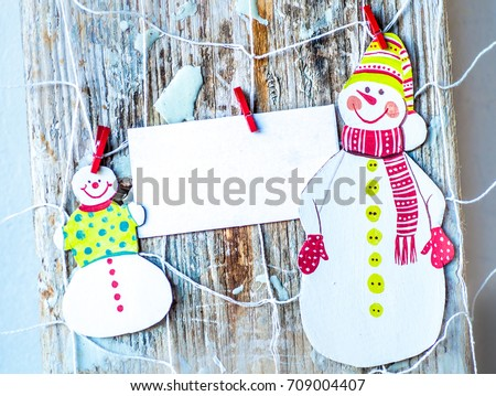 christmas ornaments over grunge wooden background vintage handmade paper christmas decoration and snow on wooden - Handmade Paper Christmas Decorations