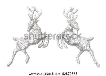 Stock Photo Christmas ornaments - two figures of glittering deer isolated on white