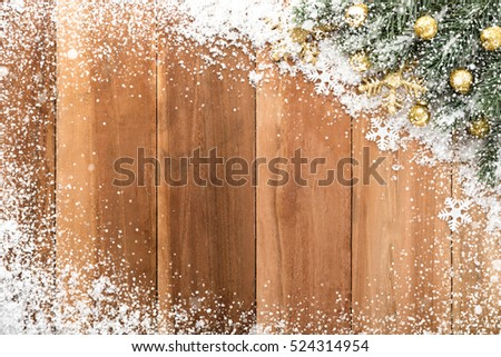 Christmas ornaments with snow on wood background, top view, border design #524314954