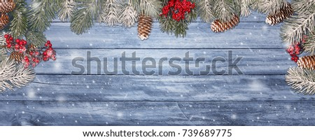 Christmas panorama banner, greeting card style with copy space, ultra large and details wood board texture framed in branches, cones and red berries, created from multiple exposures stitched. #739689775