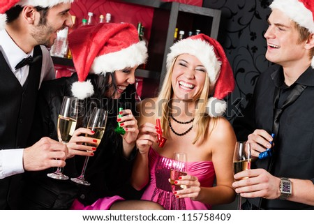 Christmas party cheerful friends at having drink and fun