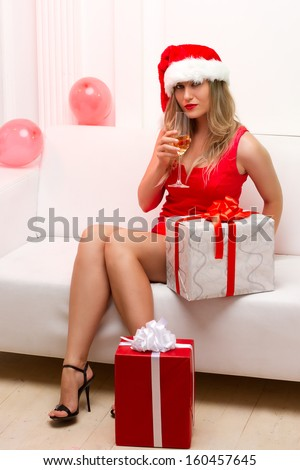 Christmas party girl with glasses of champagne