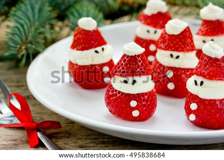 Christmas party ideas for kids - strawberry santa, strawberry mascarpone cheesecake dessert recipe #495838684