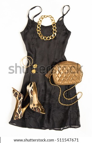 Christmas party outfit. Cocktail dress outfit, night out look on white background. Little black dress, gold bag, leopard shoes, gold necklace. Flat lay, top view