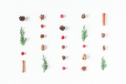 Christmas pattern of pine cones, cypress branches, cranberry, cinnamon sticks. Top view, flat lay