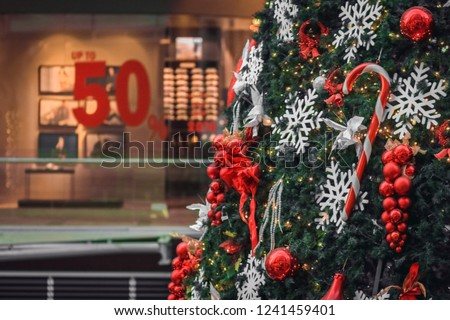 Christmas Pic. Decorated Christmas tree on blurred, 50% sale. Sale season background. Christmas tree close up.