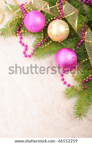 christmas pink and gold decorations on green pine branch