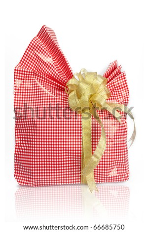 Christmas pink rose gift box tied with gold ribbon bow on white background