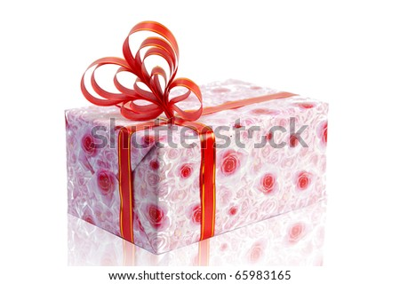 Christmas pink rose gift box tied with red ribbon bow on white background