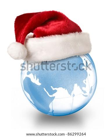 Christmas planet concept - Santa hat on globe