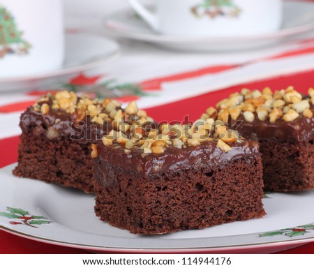 Christmas plate of fudge brownies topped with nuts