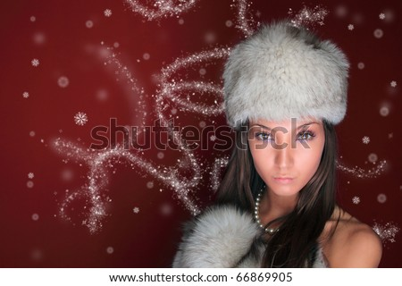 Christmas portrait of a beautiful young woman wearing a Russian hat