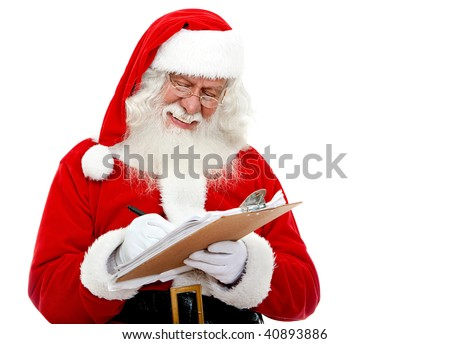 Christmas portrait of Santa Claus writing a list isolated over a white background
