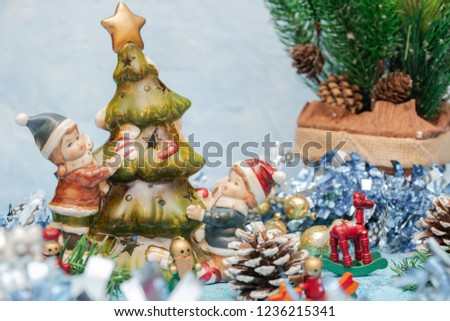 Christmas postcard decoration. Christmas tree toy with children close up. Christmas postcard composition. horizontal view.