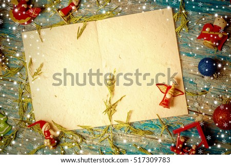 Christmas postcard , empty letter and cute christmas ornamentes on old wooden table