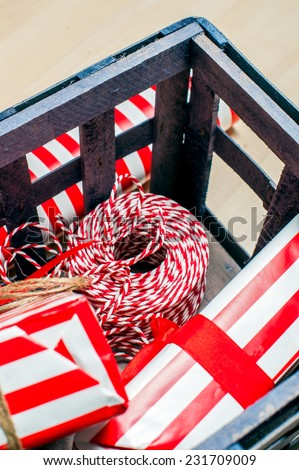 Christmas preparation. Accessories for Xmas gift packing in wood box, vertical image